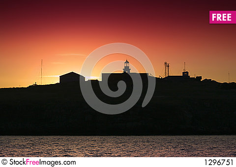 Silhouette of an island and lighthouse Stock Photo