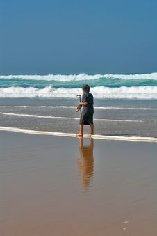 Free She Continues Walking On The Beach Royalty Free Stock Images - 1297109