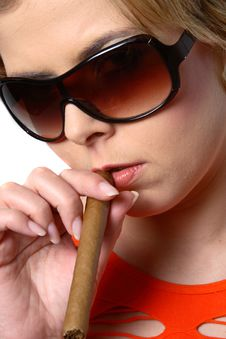 Blond Woman Smoking A Cigar With Sunglasses Stock Images