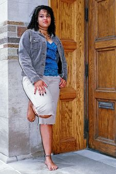Free Posing By The Door Royalty Free Stock Photography - 1297747