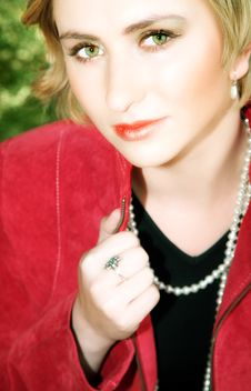 Young Blond Woman In Red Jacket Stock Images