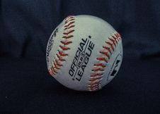 Free White And Orange Official League Baseball On Black Textile Stock Images - 129026564