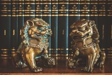 Free Two Brown Chinese Guardian Lions Figures On Table Top Royalty Free Stock Photo - 129026975