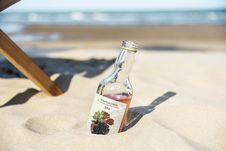 Free Close-Up Photo Of Bottle On Sand Royalty Free Stock Photo - 129029415