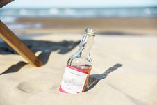 Free Close-Up Photo Of Bottle On Sand Royalty Free Stock Photography - 129029777