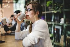 Free Photo Of Woman Drinking Coffee Stock Photography - 129029852