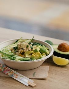 Free Salad With Sliced Avocado In Bowl Stock Photos - 129030413