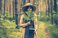 Free Woman Holding Green Leaf Covering Her Face In The Middle Of Woods Stock Image - 129031291