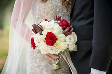 Free Bride Holding Bouquet Of Flowers Beside Groom Royalty Free Stock Image - 129031326