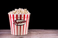 Free Popcorn In Full Retro Box On Wooden Rustic Desk Royalty Free Stock Photos - 129088938