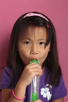 Free Asian Girl Eating Ice Pop Stock Image - 12912151