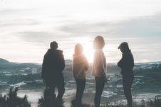 Free Four People Standing On Top Of Hill During Sunset Royalty Free Stock Photos - 129227898