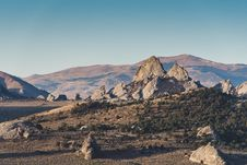 Free Rock Formations Near Mountain Stock Images - 129228414