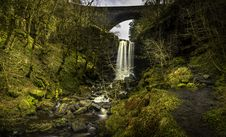 Free Waterfall Near Bridge Surrounded By Trees Royalty Free Stock Photography - 129251607