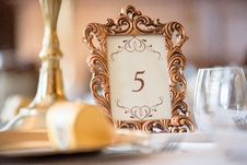 Free Selective Focus Photography Of Table Number 5 Inside Scrolled Photo Frame On Table Royalty Free Stock Photos - 129251628