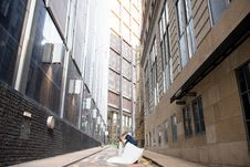 Free Kissing Couple Between Buildings Royalty Free Stock Image - 129251696