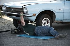 Free Man Working Under His Car Royalty Free Stock Image - 129414616