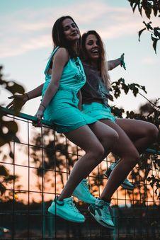 Free Two Girls Sitting On Gray Metal Rail Stock Images - 129414674