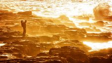 Free Man Standing On Rocky Shore During Sunset Stock Photo - 129414760