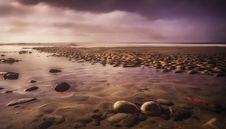 Free Seashore With Rocks At Sunset Royalty Free Stock Photos - 129414778
