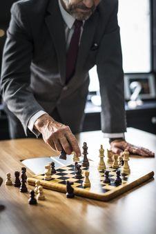Free Man Playing Chess Royalty Free Stock Image - 129414976
