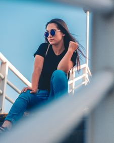 Free Woman Sitting On Stairs Posing For Photo Stock Photos - 129415053