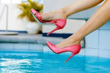 Free Woman Swinging Her Foot Above Pool Water Royalty Free Stock Images - 129415239
