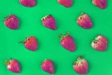 Free Strawberries On Green Background Stock Photo - 129415340