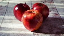 Free Three Red Apples On Wooden Surface Royalty Free Stock Image - 129415396