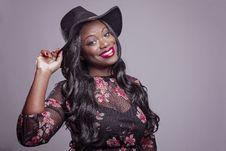 Free Smiling Woman Holding Black Hat Stock Image - 129415541
