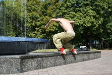 Free Aggressive Inline Rollerblader On A Ledge Stock Photo - 12953120