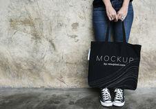 Free Woman Carrying Black Mockup Tote Bag Royalty Free Stock Photography - 129501117