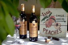 Free Two Red Wine Bottles Beside Clear Wine Glass Stock Images - 129501264