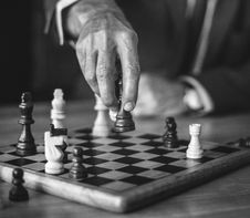Free Grayscale Photo Of Person Holding Chess Piece Royalty Free Stock Photos - 129686568