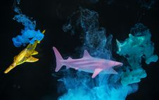 Free Two Yellow And Pink Sharks Emitting Smokes Stock Photography - 129786622