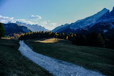 Free Gray Pathway Between Green Grasses Near Snow Capped Mountain Royalty Free Stock Image - 129786876