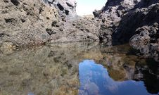 Free Rock, Water, Reflection, Wilderness Stock Photography - 129937032