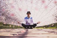 Free Man Meditating In The Middle Of Pathway Stock Photography - 129940122
