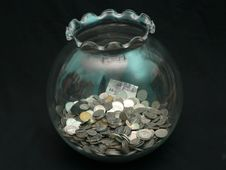 Coin In Jar Stock Photo