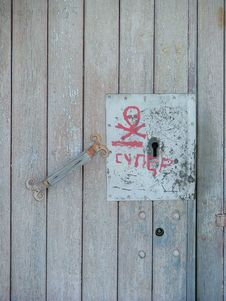 Wooden Door With Red Writings On It Royalty Free Stock Images