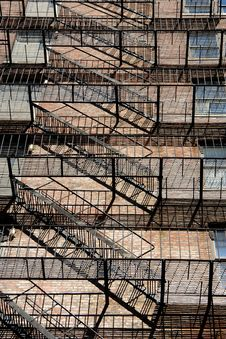 Free Zig Zagging Fire Escape On Back Of Old Apartment Building Royalty Free Stock Photos - 1304298