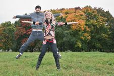 Free Autumn Couple Jump Stock Photography - 1306842