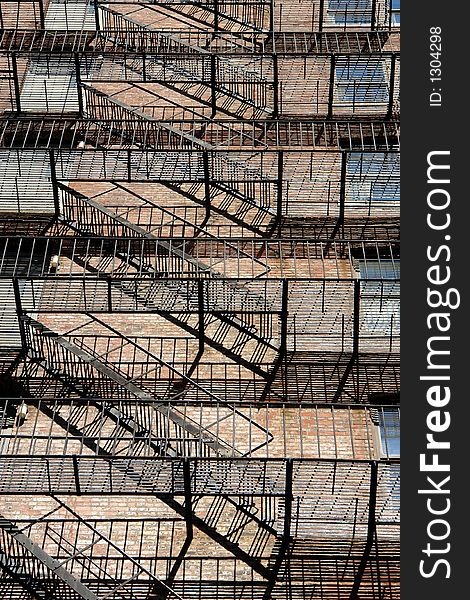 Zig zagging fire escape on back of old apartment building