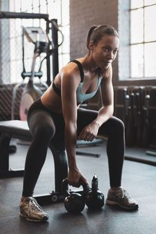 Free Woman Workout Inside Gym Stock Image - 130178601