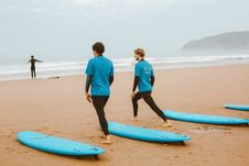 Free Photo Of Male Surfers Stretching On The Beach Stock Image - 130178691
