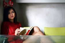 Free Photo Of A Woman In Red Dress Holding A Book Stock Image - 130289081