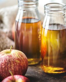 Free Close-up Photography Of Honeycrisp Apples And Two Clear Glass Bottles Filled With Liquid Stock Images - 130289834