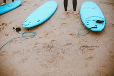Free Three Blue Tow Surfboards Placed On Brown Sand Royalty Free Stock Photo - 130290175