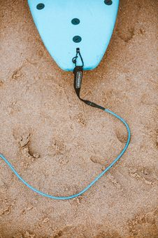 Free Photo Of Blue Surfboard With Leash On Sand Stock Photo - 130291200