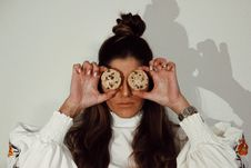 Free Woman Covering Eyes With Two Chocolate Chip Cookies Royalty Free Stock Images - 130422689
